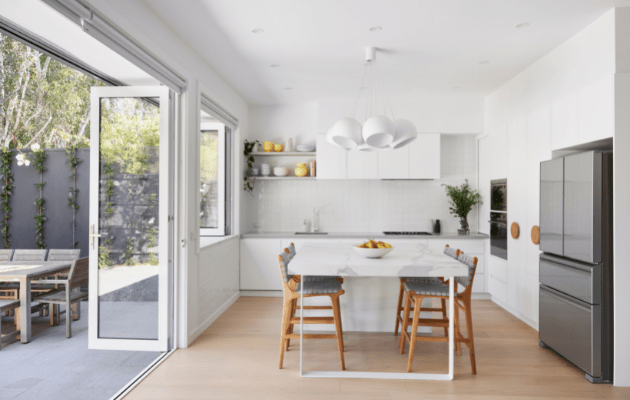 Smarter Bathrooms and Kitchens - a modern kitchen in Brunswick Home with teardrop lights, beautiful wooden floors, light filled kitchen built by kitchen renovations Melbourne specialist.